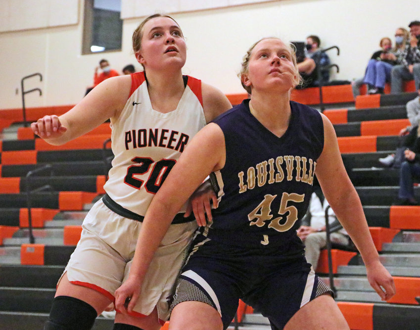 Pioneers senior Rianna Wells, left, and Louisville's Erin Stohlmann get into position to rebound on a free throw attempt Tuesday at Fort Calhoun High School.