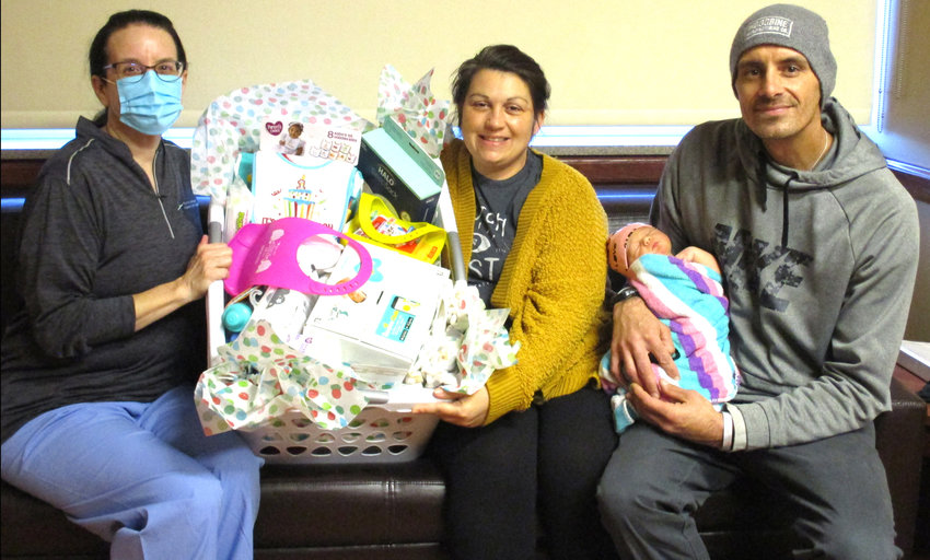 Meah Marie-Lynn Robins was delivered at 8:39 p.m. by Dr. Sandra Baumberger, left. She weighed 7 pounds, 12 ounces and was 20.5 inches. Her parents, Genie Burgmeyer and Joshua Robins, of Blair, found out their baby was the first one born of the new year.