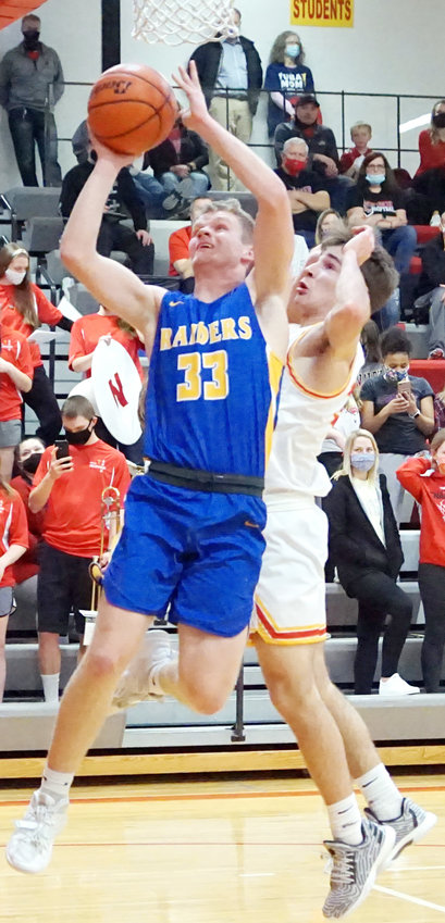 Jayden Korman #33 gets past the Neumann defender and lays it in off the glass for two.  Jayden scored 13 points in the win over Bishop Neumann. .
