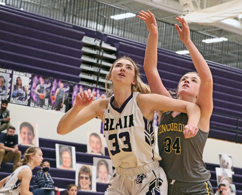 Bears senior Maicy Lourens, left, boxes out Omaha Concordia's Kaylie Crom on Tuesday at Blair High School.