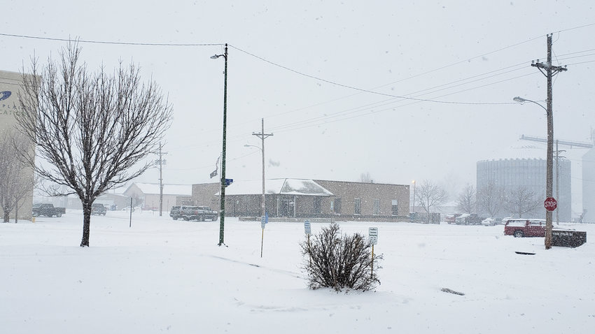 Snow falls in Blair on Monday morning. The storm was expected to drop nearly a foot of snow in some places.
