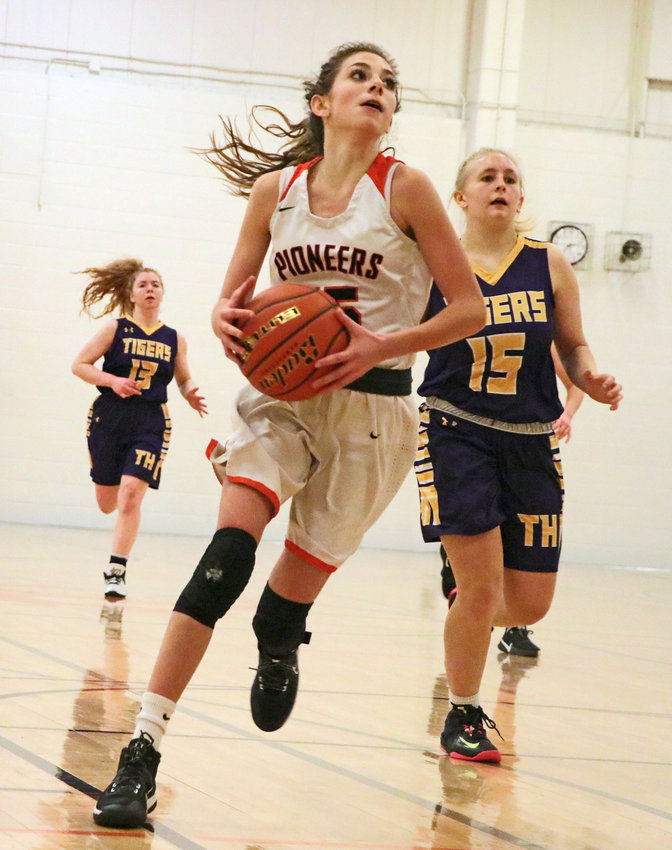 Pioneers junior Tess Skelton drives to the basket Friday at Fort Calhoun High School.