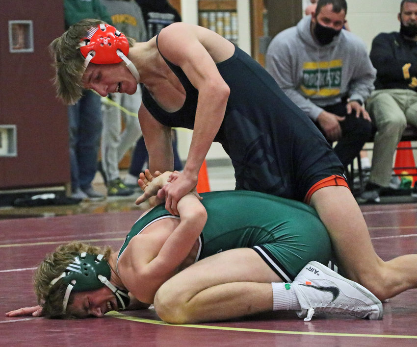 Pioneers 120-pounder Lance Olberding, top, controls the arm of Syracuse's Jace Goebel on Saturday during the Nebraska Capitol Conference Tournament at Arlington High School.