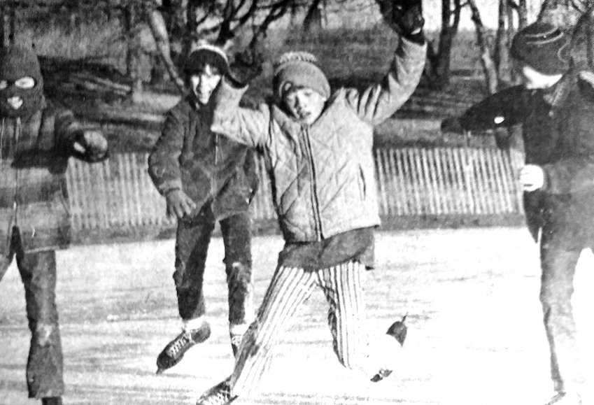 Jeff Anderson, from left, Shawn Carey, Jeff Sterner and Mark Madsen ice skate in 1972 at Blair's outdoor rink.