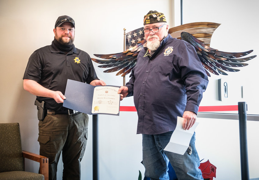 Washington County Sheriff's Detective Brian Lundgren, left, receives the Sheriff of the Year Award from Blair VFW Post 1251 Commander Denny Webb on Wednesday.
