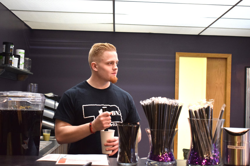 Evan Eledge, owner of Blair Bear Nutrition, prepares a coffee in the newly opened business at 1526 Washington St.