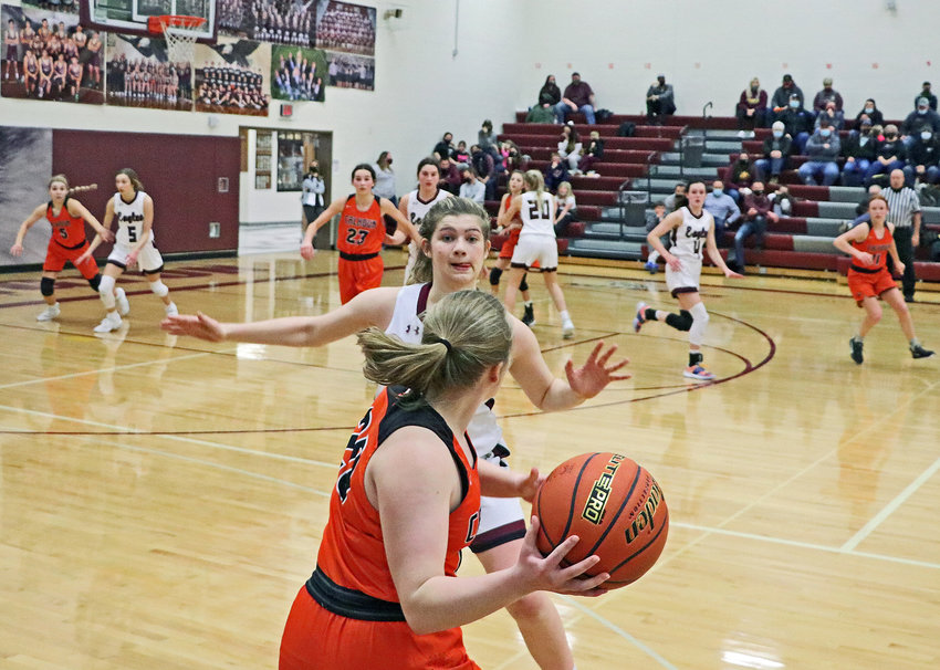 Fort Calhoun senior Rianna Wells inbounds the basketball as the Eagles' Kate Miller defends late during Friday's NCC Tournament consolation game at Arlington High School.