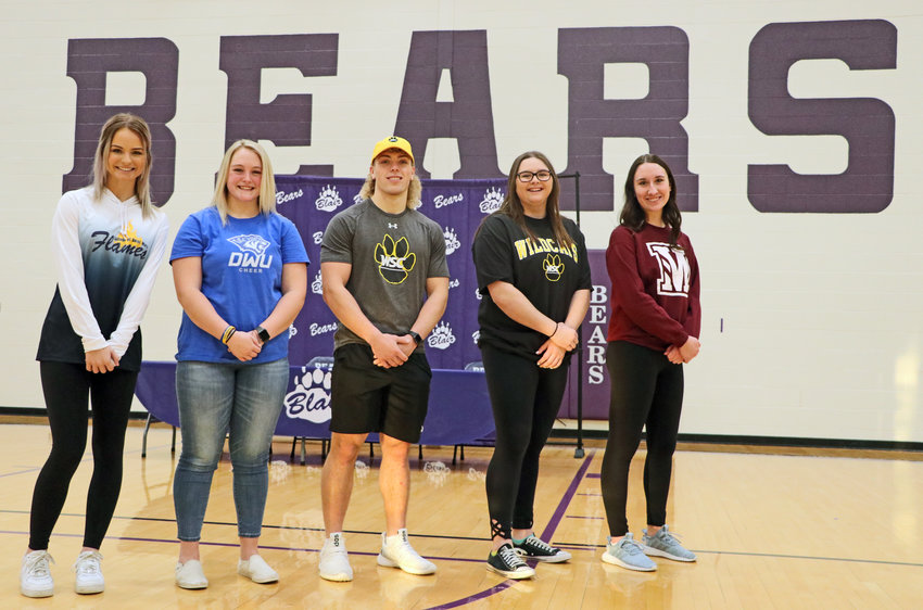 Blair High School seniors Hannah Koch, from left, Kylie Quick, Dex Larsen, Hailey Baker and Rachel Parks made their college decisions official Wednesday morning, taking part in national signing day.