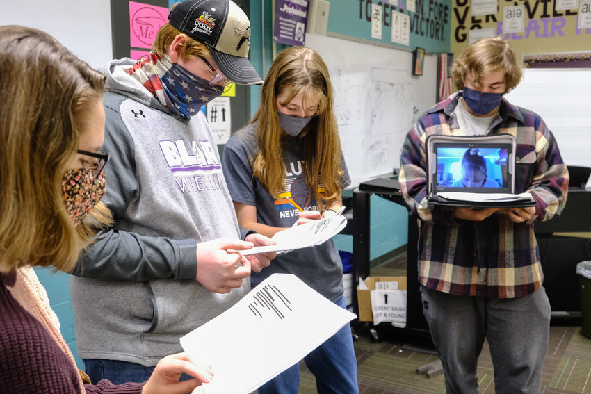 "The cast of ""The Norse Mythology Ragnasplosion"" rehearses Monday at Blair High School. Pictured, from left, are Jacinta Flynn, Aaron Pierce, Ruby Gutzman and director Chase Jensen holding laptop with virtual cast member Olivia Nelson."