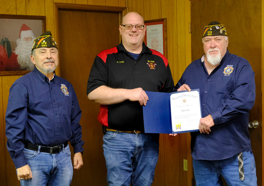 Blair VFW Post 1251 Senior Vice Commander Dan Falcon, left, and VFW Commander Denny Webb, right, present the Firefughter of the Year Award to Dave Aten at a ceremony on Thursday..