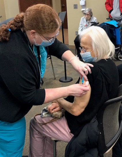 Keala Roy, emergency department manager, administers a COVID-19 vaccine Thursday at Memorial Community Hospital and Health System. There were 150 vaccines distributed Thursday.