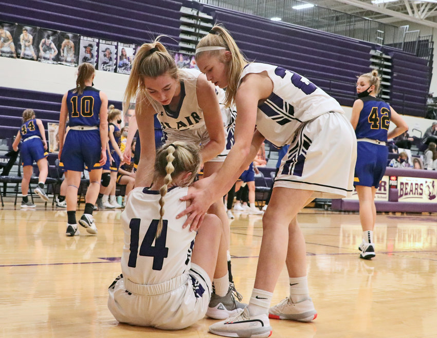 Bears Maicy Lourens, left, and Nessa McMillen, right, help up teammate Kalli Ulven a tumble to end the first half Friday at Blair High School.