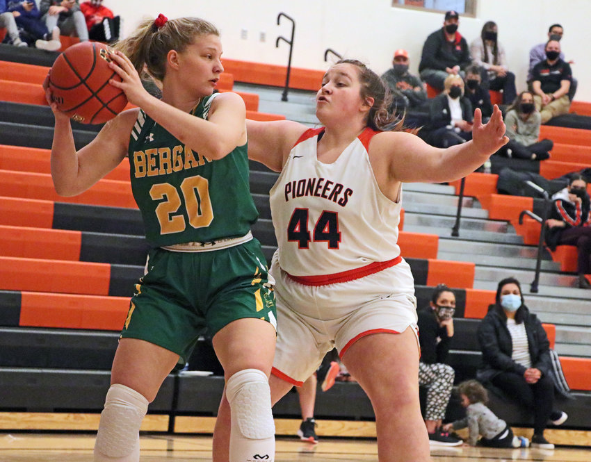 Pioneers senior Abigail Ryan, right, defends against Fremont Bergan's Lauren Carlson on Thursday at Fort Calhoun High School.