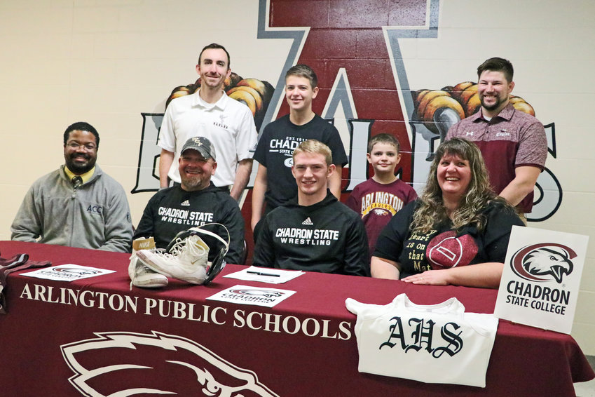 Arlington senior Hunter Gilmore will continue his wrestling career into college after signing with Chadron State College on Thursday.