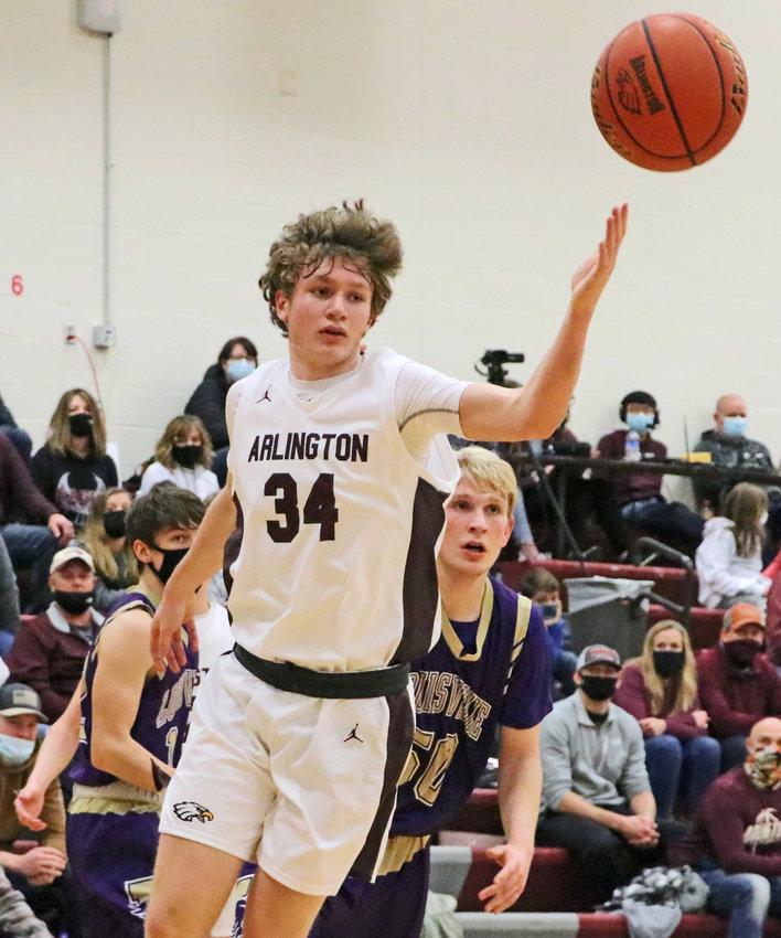 Eagles senior Aiden Foreman reaches for the ball Friday at Arlington High School.