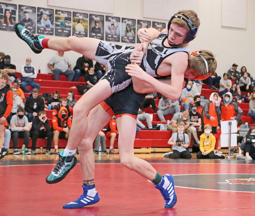 Fort Calhoun 113-pounder Ely Olberding, right, picks up his opponent Saturday at Albion Boone Central.