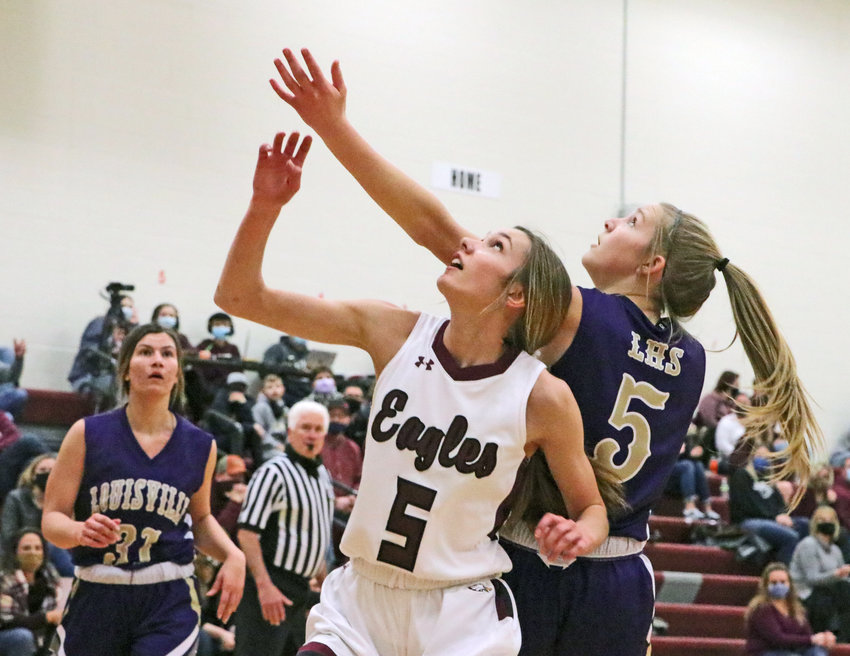 Arlington junior Kailynn Gubbels, facing, gets into position for a rebound Feb. 12 during the Eagles' regular season finale. On Monday, the AHS guard led her team in scoring in its subdistrict victory against Logan View/Scribner-Snyder.
