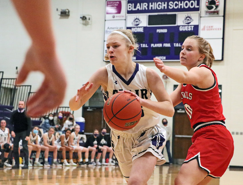 Somewhere between the referee's hand and South Sioux City's Aubree Van Berkum, right, Bears freshman Nessa McMillen drives to the rim Tuesday during the subdistrict title game at Blair High School.