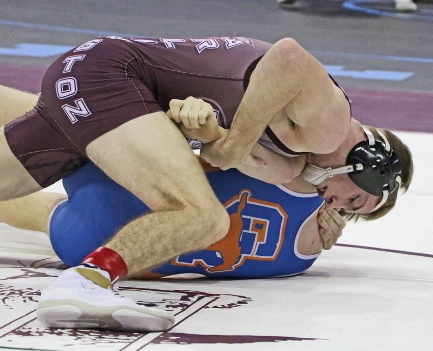 Arlington 145-pounder Hunter Gilmore, top, works to turn Gordon-Rushville's Jace Freeseman on Friday in Omaha.