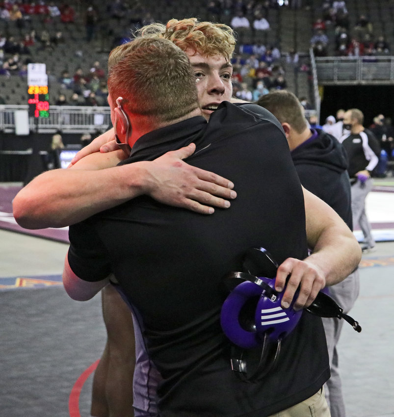 Blair senior Dex Larsen embraces coach Will Schany on Saturday after qualifying for a 195-pound state championship match Saturday in Omaha.