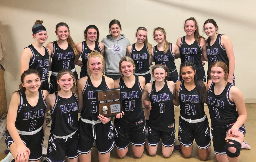 The Blair girls basketball team poses with their district runner-up plaque on Saturday in York. Team members are, front row, from left: Sami Murray, Reese Beemer, Maicy Lourens, Ella Ross, Mya Larson, Allison Hernandez and Kaitlyn Johnson. Second row: Nessa McMillen, Joslyn Policky, Maggie Valasek, Avory French, Leah Chance, Kalli Ulven, Makayla Baughman and Jordan Wolfe.