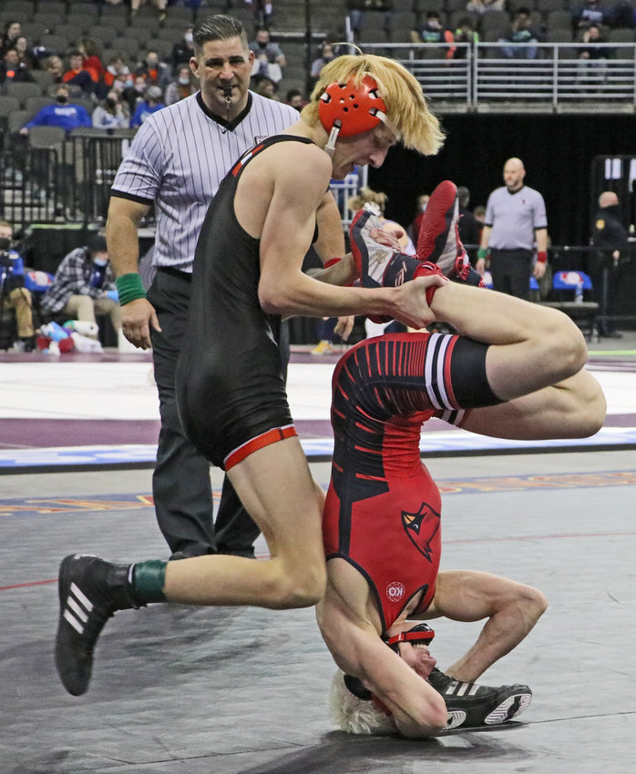 Fort Calhoun 120-pounder Lance Olberding, left, tries to pull Albion Boone Central's Gavin Dozler on Saturday during a third-place match in Omaha.