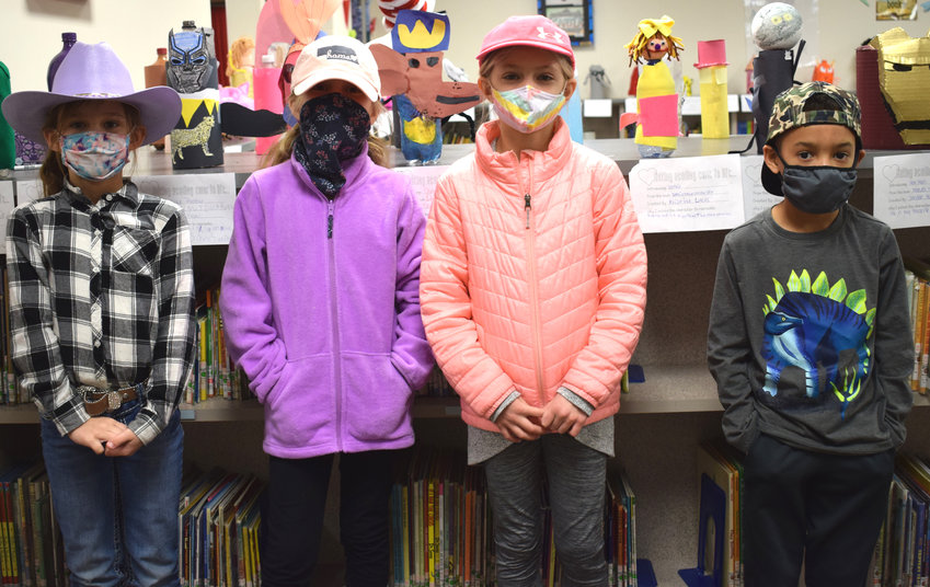 As part of Read Across America Week, students could wear hats or funny socks on Monday at Arlington Public Schools. Pictured, from left, are second-graders Lillian Lage, Eden Classen, Sophie Hansen and Junior Cole.