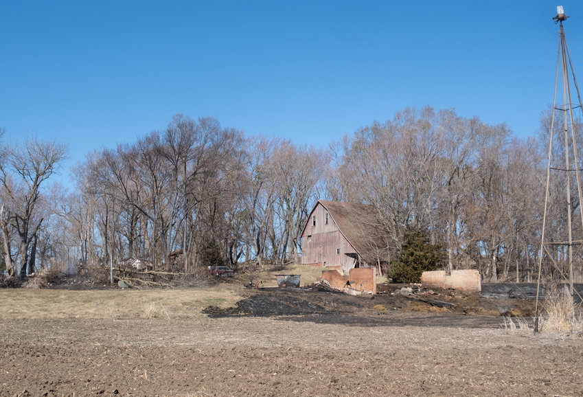 An unoccupied home and barn near County Roads 31 and 36 burned down Wednesday afternoon. The blaze carried across the corn fields and creek and spread across a field on CR 36.
