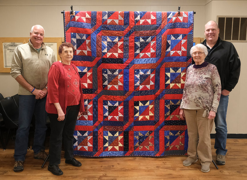 Quilter Darlene Harper, second from right, donated the Quilt of Valor quilt to Sons of the American Legion (SAL) to be raffled to raise funds for SAL projects. Pictured, from left, are: Rick Paulsen, quilt raffle winner Ann Persson, Harper and Jim Sandvold. ....