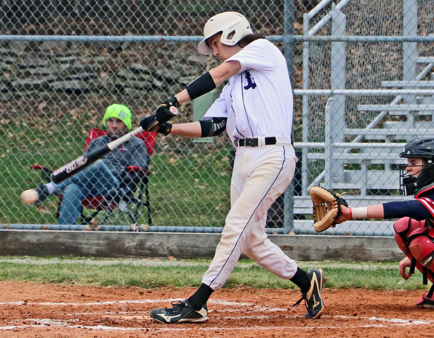 Blair catcher Conner O'Neil puts the ball in play against Platteview on Thursday at Vets Field.