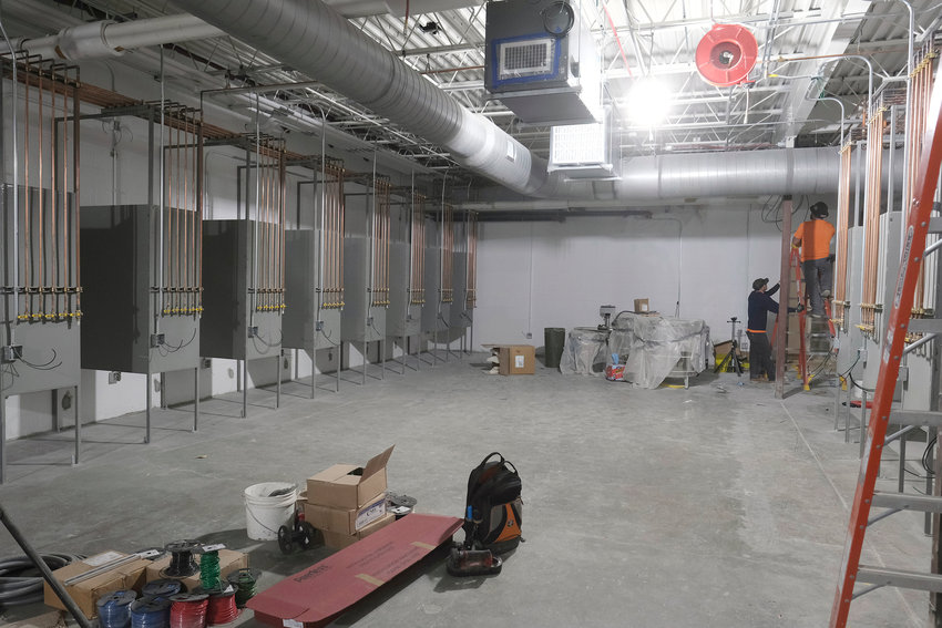 A construction crew works on the renovations in the welding area Monday at Blair High School.