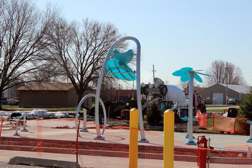 The splash pad, part of the proposed park for the Adam Street Cooridor, is expected to be complete by Memorial Day. The splash pad will have several features including a dump bucket.