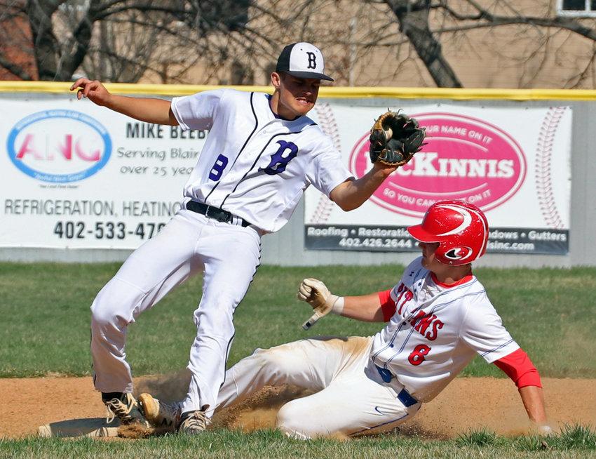 Blair infielder Nolan Osterhaus, left, snags a throw to second base as Norris' Eaden Holt slides in safe Friday at Krantz Field.