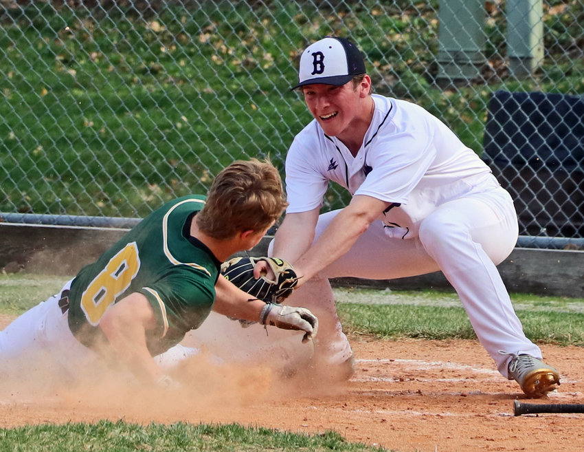 Blair pitcher Morgan Rump, right, tries to tag Gretna's Graham Johnson out at the plate Tuesday at Vets Field.