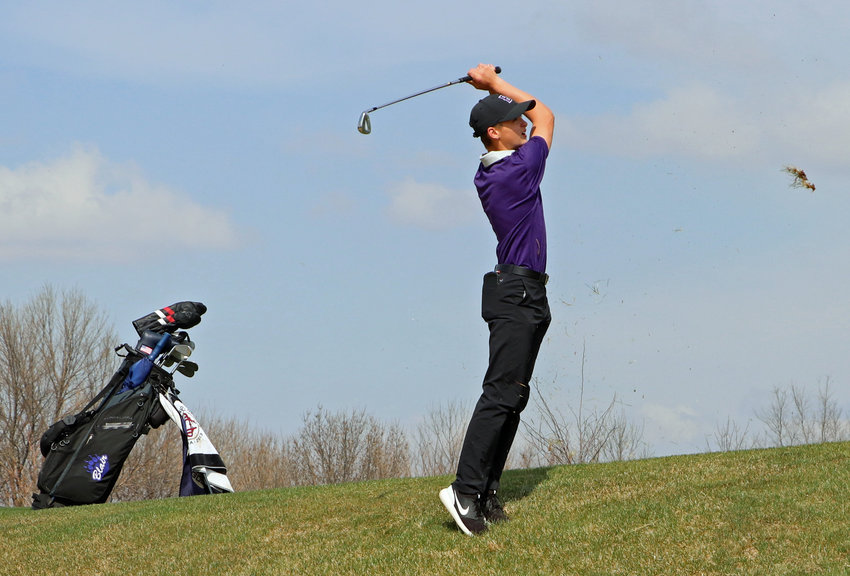Blair Bear Easton Chaffee watches his shot off of a steep slope on No. 2 Tuesday at River Wilds Golf Club.