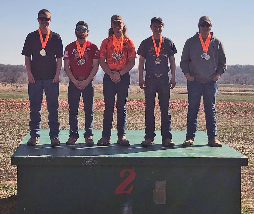 Blair Youth Shooting Sports Senior Division marksmen pose for a photo on top of a traphouse, celebrating last Saturday's success in Omaha during a Eastern Cornhusker Trapshooting Conference shoot.