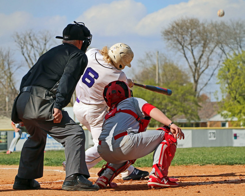 Blair senior Dex Larsen, middle, fouls off a South Sioux City pitch before hitting a first-inning RBI triple Tuesday at Vets Field.