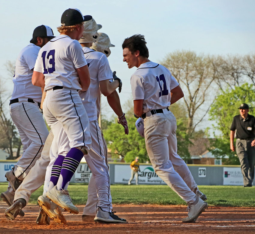 Blair freshman Brady Brown, right, celebrates his walk-off grand slam with the Bears on Monday at Vets Field.