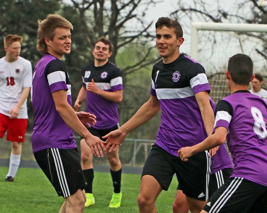 Blair senior Gabe Zurek, second from right, celebrates a first-half goal with his teammates Tuesday at Krantz Field.