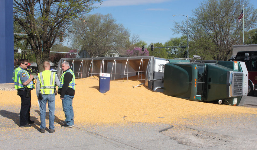 Blair police responded to the scene of a semi overturned at 19th and Washington on Friday morning in Blair. A load of corn was dumped on the corner during the accident.