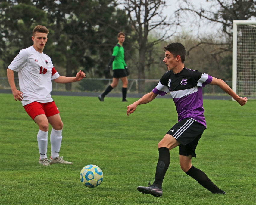 Blair's Victor Dufau, pictured here against Elkhorn, right, and his teammates scored eight goals Saturday during the first round of their subdistrict tournament in South Sioux City.
