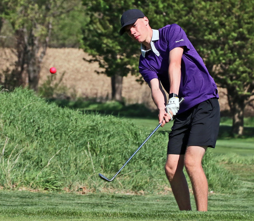 Blair Bear Cole Wilkins chips onto the green Thursday at River Wilds Golf Club.