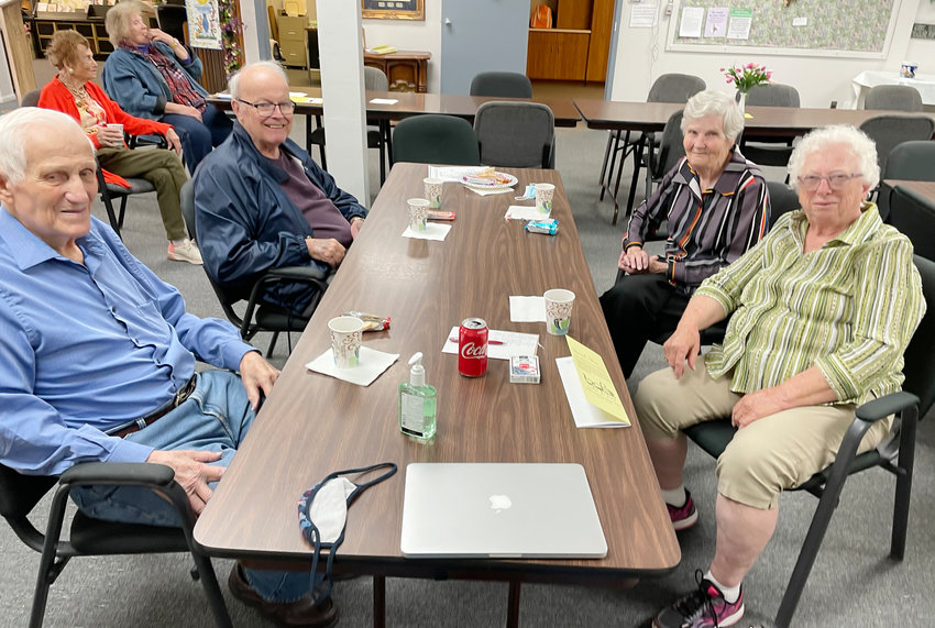 Back in the Saddle Again - Golden Oaks saw as many as 20 for coffee on when the senior center opened their doors again on Monday.  Vince Lindstrom, Ed Anderson, Sue Johnson and HIlda Benne couldn't wait to get back to play cards on Tuesday.