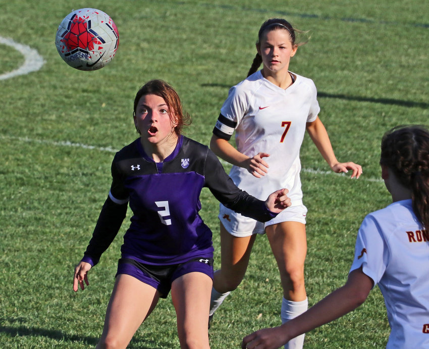 Blair junior Sami Murray, left, locks onto a throw-in against Omaha Roncalli on Monday during the Class B-3 Subdistrict Tournament at Omaha Duchesne.