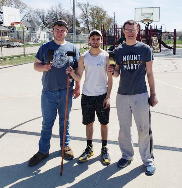 Chad Christoffersen, Mason Lami, Zach Hegge, taking pride in their community studio project of painting the LDNE basketball court.