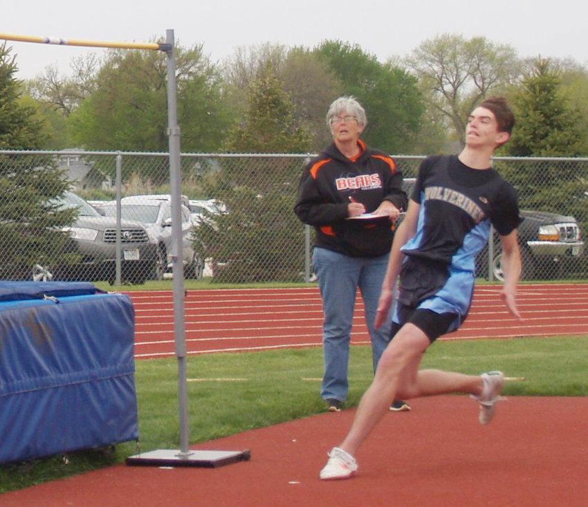 Elliott Nottlemann makes his state qualifying approach in the high jump.