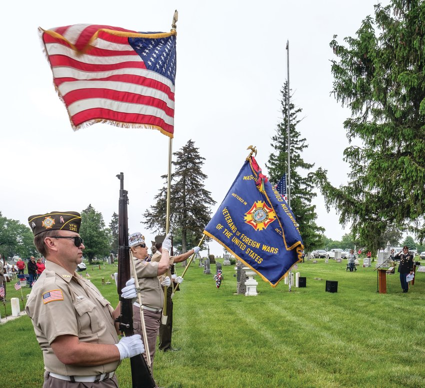 VFW Post 1251 Color Guard stands at attention during the playing of the national anthem last year during a Memorial Day ceremony at the Blair Cemetery.