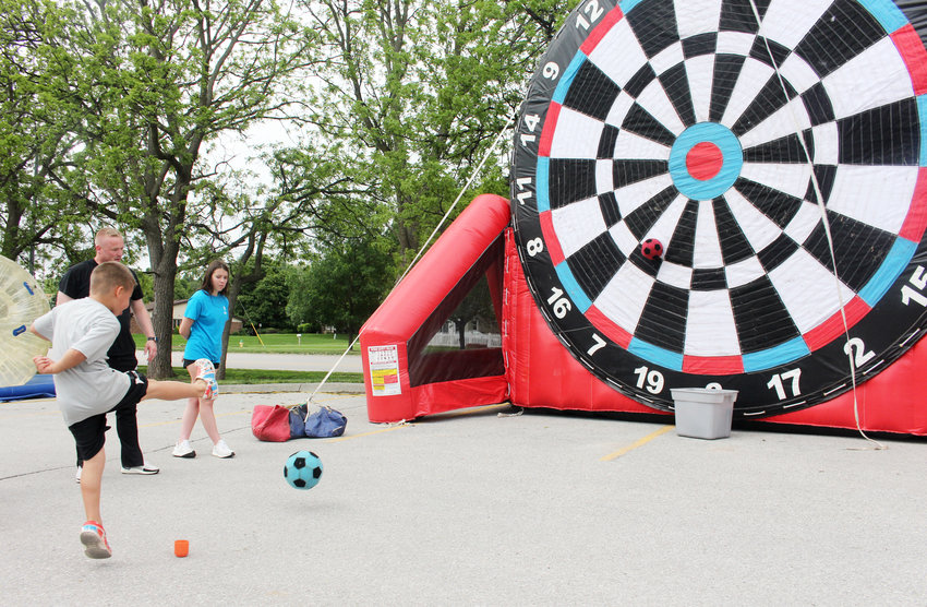 Kids took aim at a giant inflatable dart board Saturday during the Healthy Kids Day and Community Block Party at the Blair Family YMCA.