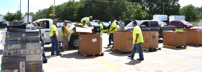 Cars lined up at the Papio-Missouri Natural Resources District parking lot in Blair to drop off electronics to be recycled on Tuesday.