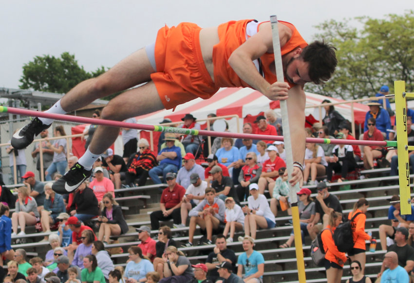 Trey Deemer lays out to clear the bar in the high jump at the State Track Meet.